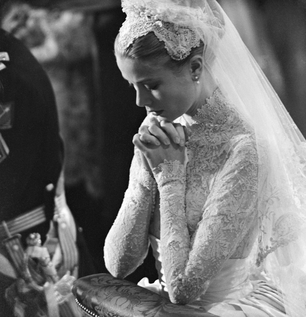 Grace Kelly prays during her wedding to Prince Rainier of Monaco on April 20, 1956.
